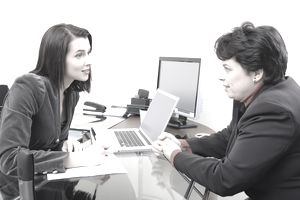 A woman is sharing issues with her HR manager
