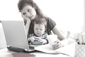 Mother working from home with baby, frustrated