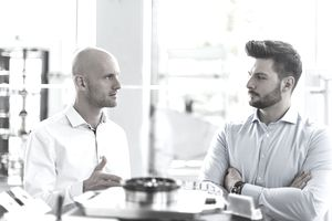 Man is discussing his work with his micromanaging boss who wants to know everything every day.