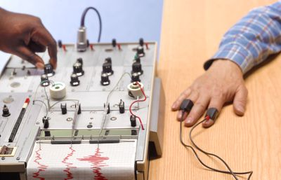 Man taking a polygraph exam as part of qualifying for a job in security.
