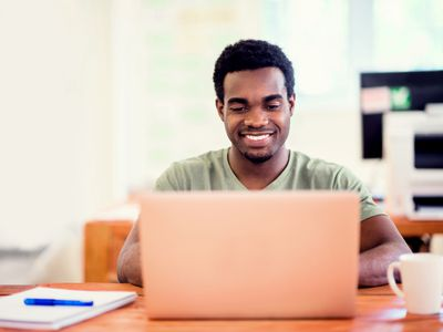 Man writing a cover letter on a laptop