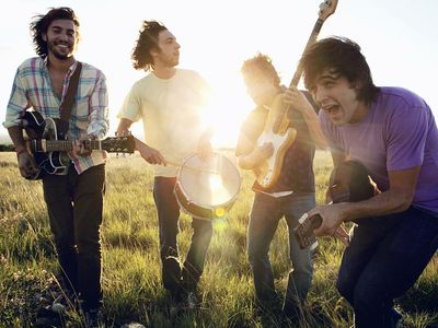 band members performing in a field