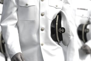 U.S. Naval Academy midshipman in dress uniform with combination cover.