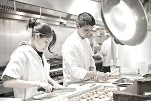Chefs prepare appetizers in kitchen