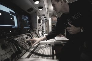 Air Force Cyber Surety Officers in Missile Silo at a launch console.