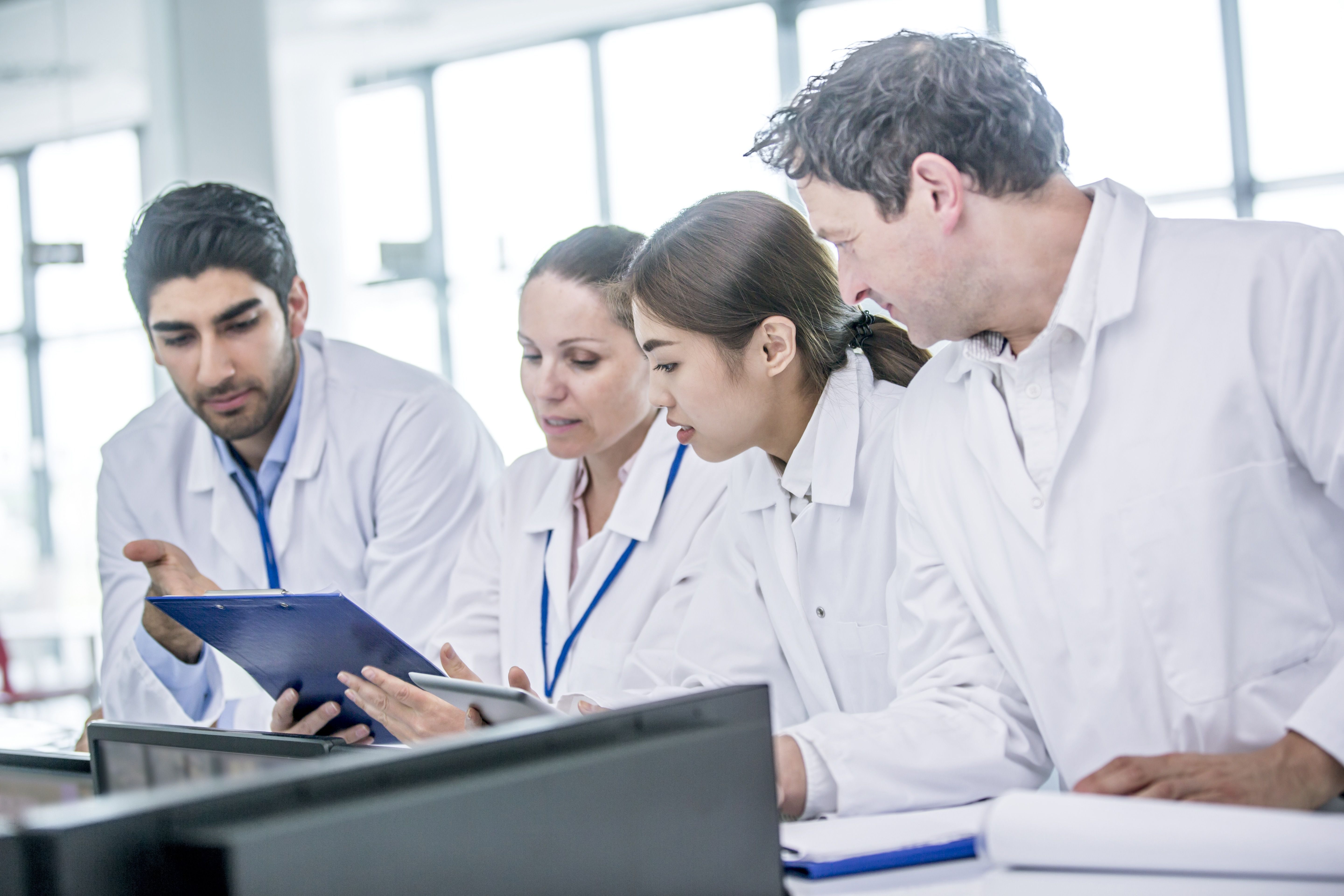 Medical students with clip board