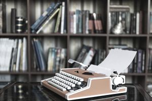 Vintage typewriter sitting on a library table