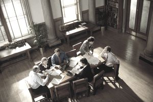 An elevated view of lawyers working in a conference room