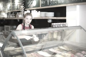 Young woman working in ice cream shop