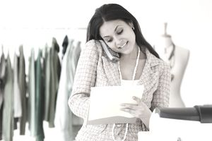 Mixed Race Woman Working at Clothing Shop