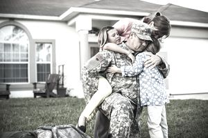 Family in military embrace