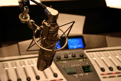 Recording a commercial with a radio station microphone