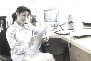 Woman in home office with telephone headset