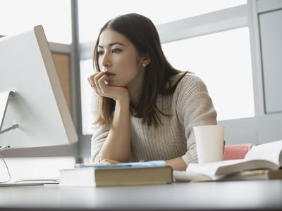 Woman looking up company reviews online.