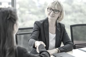 Cheerful HR manager handshake with female candidate at job interview. Business agreement, Employee, career concept.