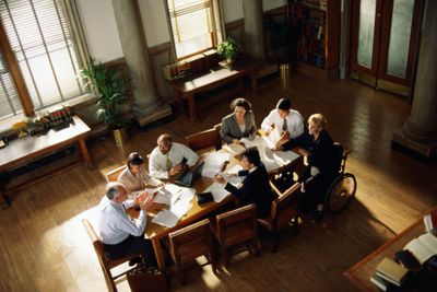 Lawyers meeting in conference room, elevated view