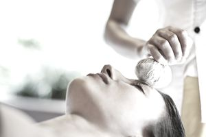 Woman receiving facial at spa