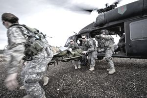 U.S. Army medical personnel offload a simulated injured soldier from a U.S. Army HH-60L Black Hawk helicopter