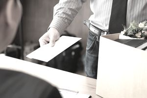 Midsection Of Employee Giving Resignation To Employer In Office