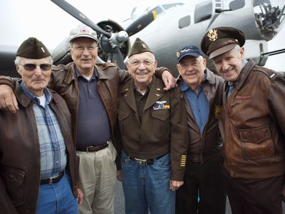 Veterans smiling in uniform and casual clothing