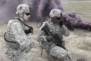 Georgia Army National Guardsman 2nd Lt. Tye Walden, platoon leader, relays radio traffic to Pvt. David Lemons during a live fire exercise at the Georgia Garrison Training Center, Fort Stewart, Ga. The platoon leader and radio operator relayed fire commands to the fire tTeams on the firing line during a combined arms live fire exercise at the 48th Infantry Brigade Combat Team's eXportable Combat Training Capabilities (XCTC) training at Fort Stewart