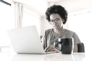 Young woman is using a laptop at home.