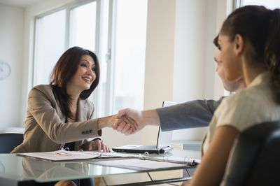 Person shaking hands after a successful salary negotiation.