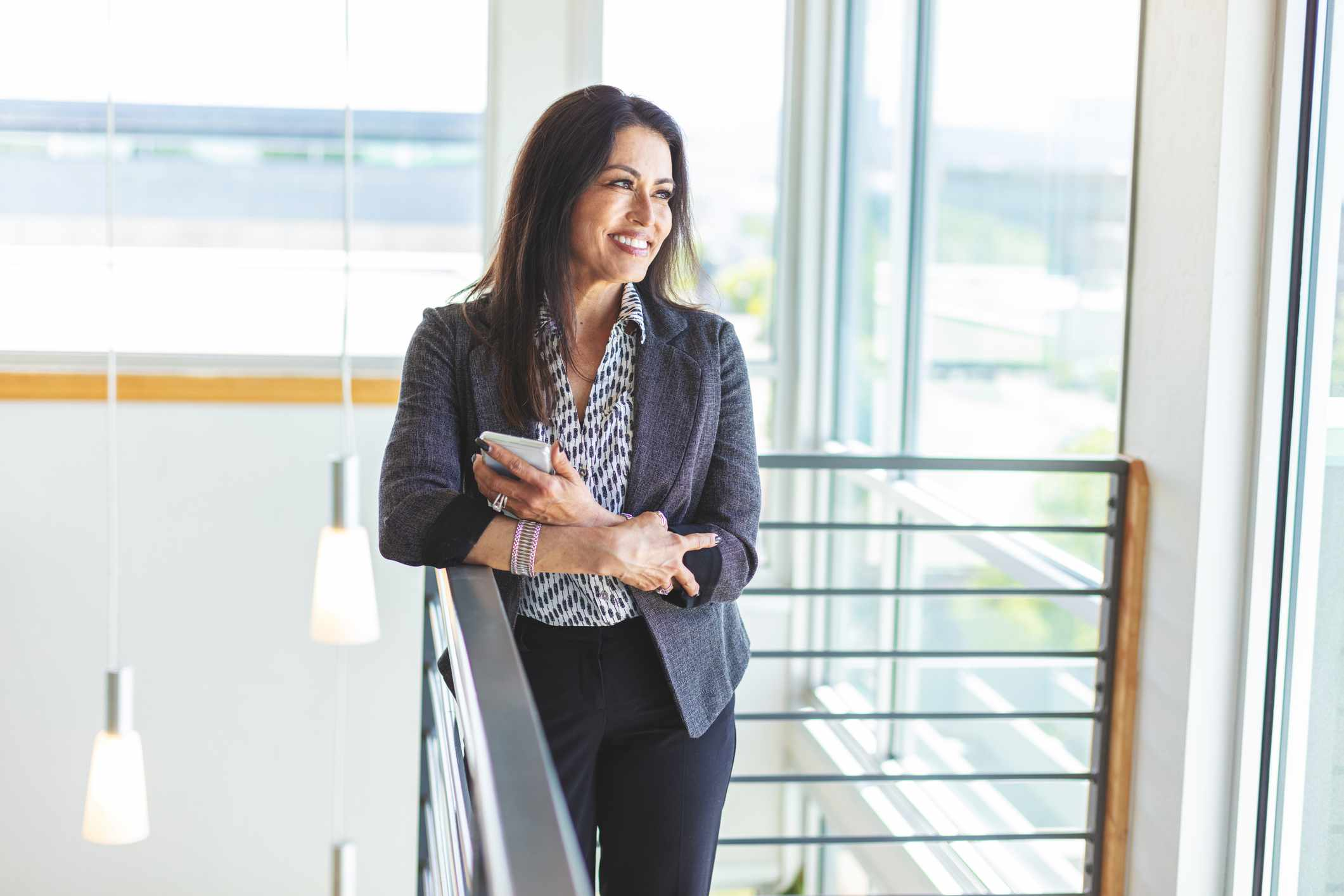 Hispanic Businesswoman Mature Adult Conducting Business in Corporate Office Space in Western Colorado