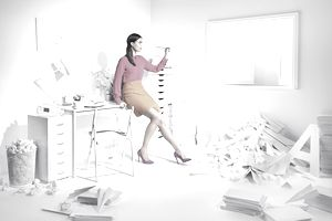 Woman in a white room with paper planes