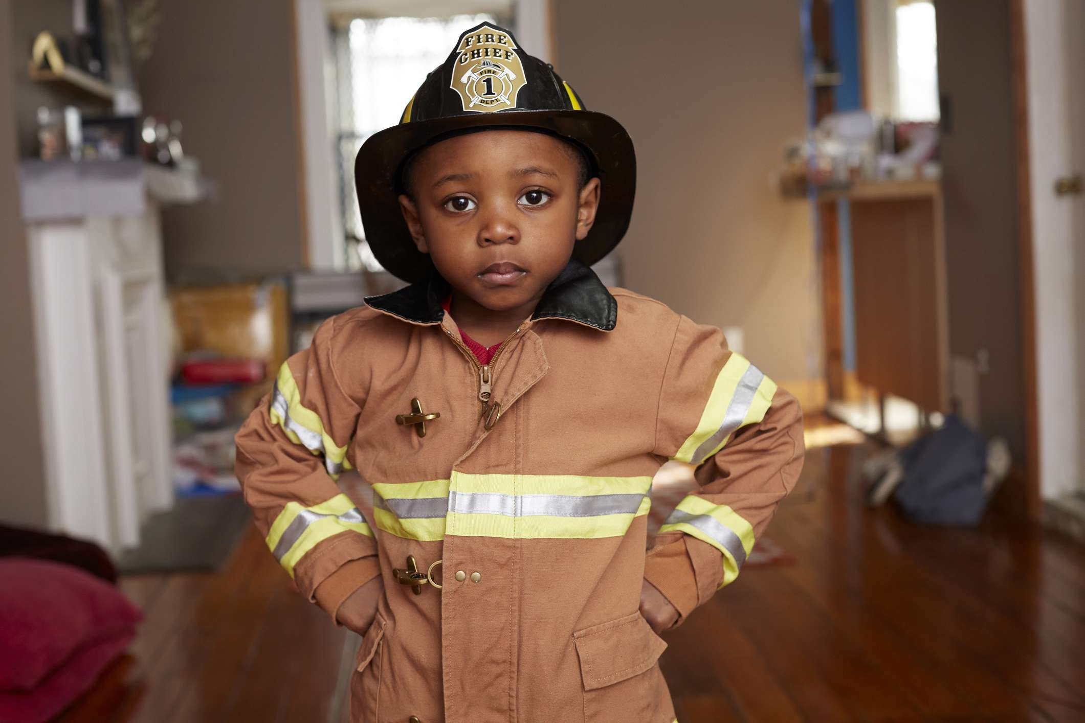 Boy dressed in firefighter costume