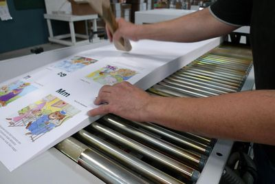 A worker working on a book in the production process