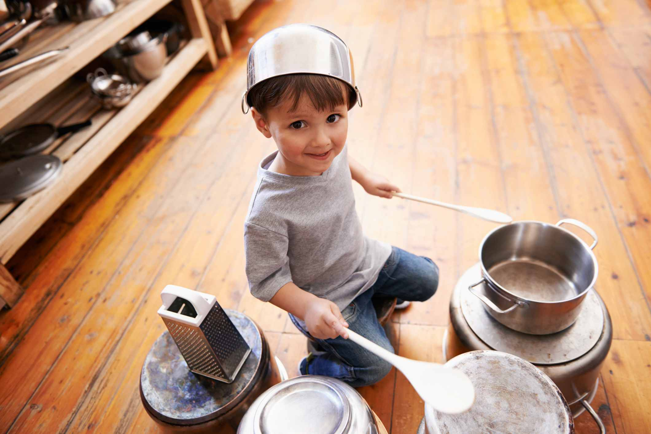 Boy playing on pots and pans