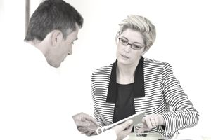 Woman discussing her salary requirements in an job interview.