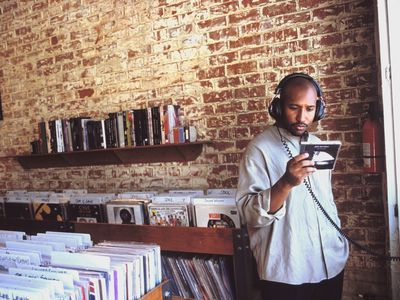 Man listening to album in record store