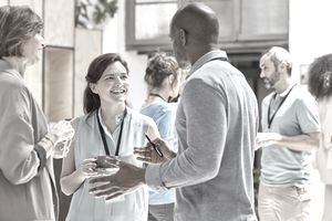 young professionals chatting at a networking event