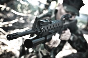 close up of M16 and grenade launcher