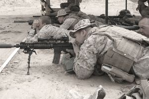 Marine Corps marksmanship coaches train shooters for combat situations.