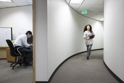 Asian businessman working alone in his office
