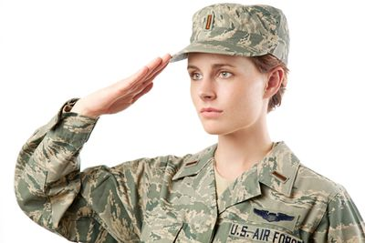 Air Force Airwoman in uniform giving salute.
