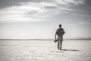 Soldier walking in remote desert