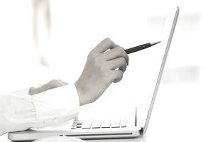 Person pointing pen a laptop screen