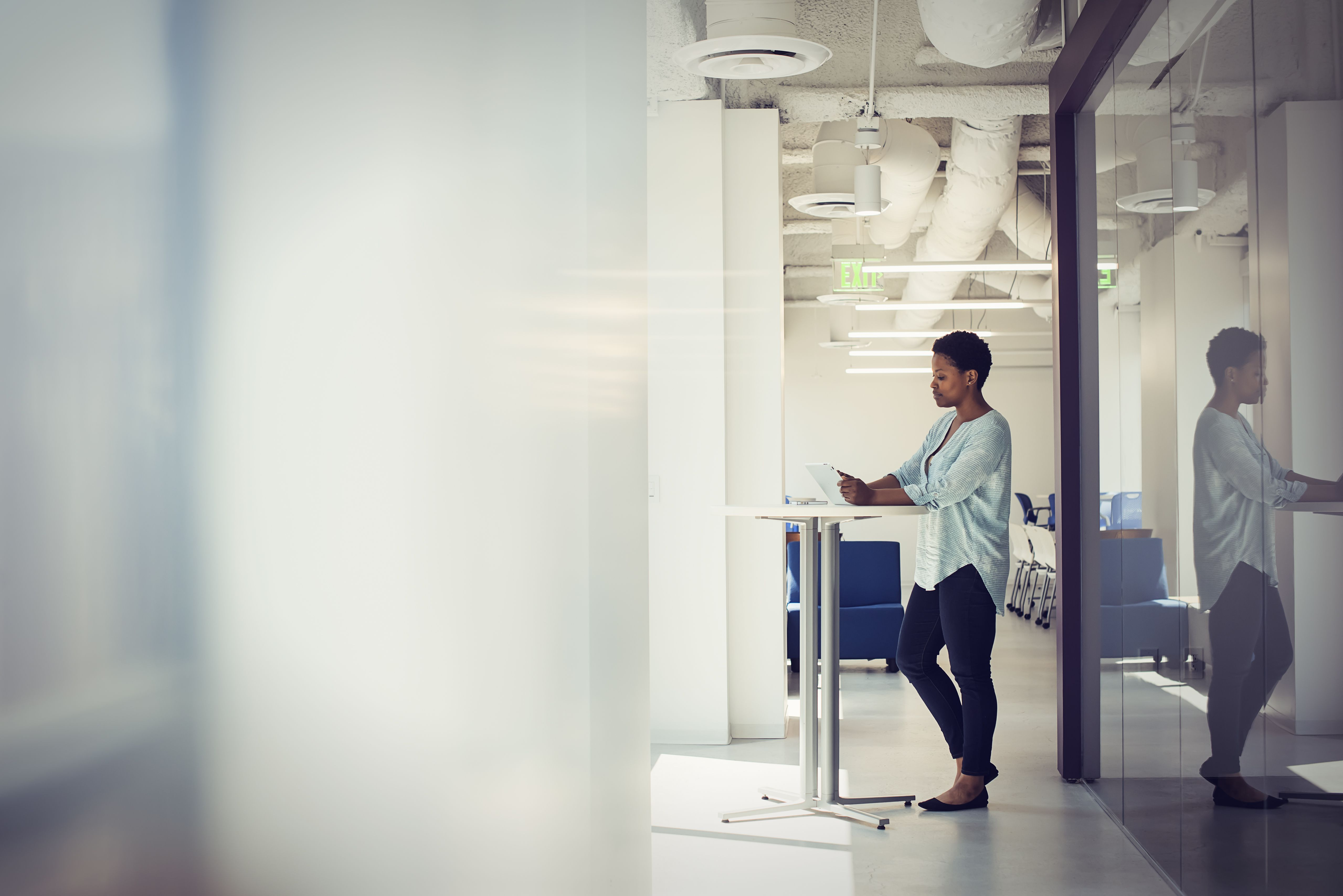 Female working on tablet in business office