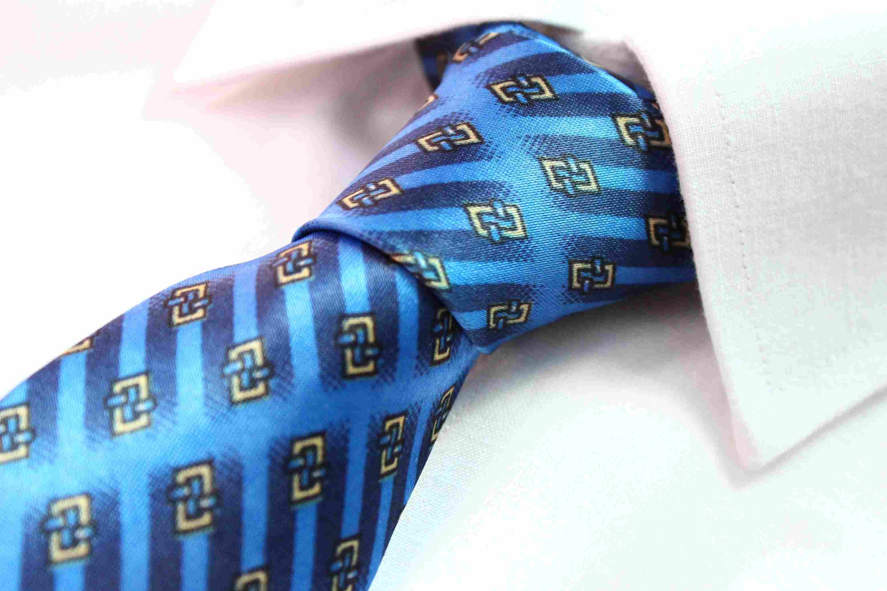 Close up of a blue patterned tie