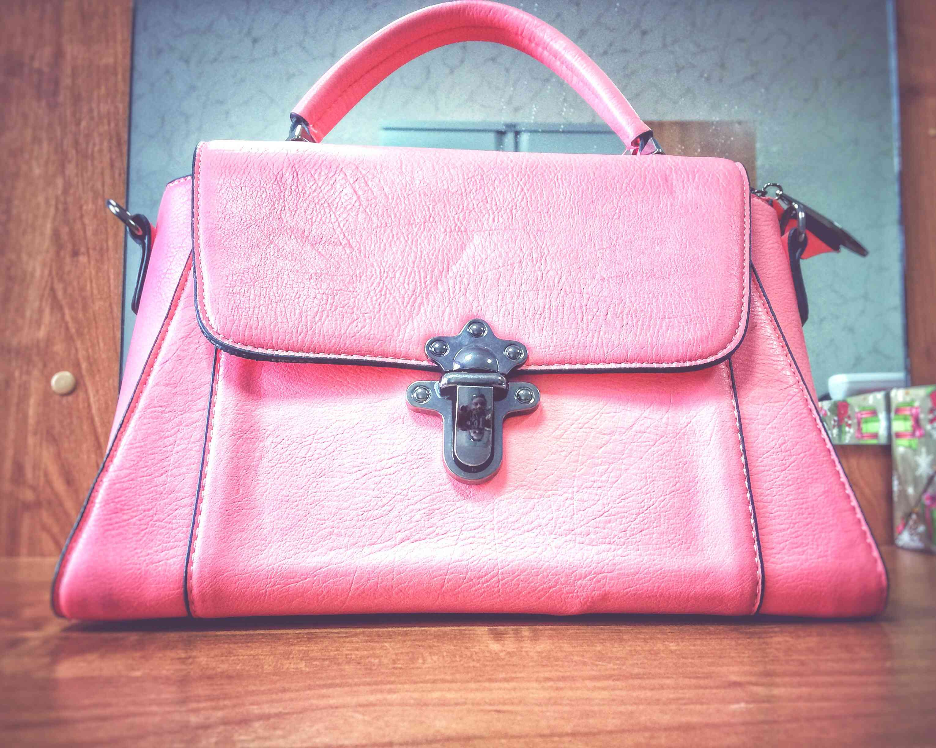 A bright pink handbag may not be a good choice to carry to a job interview.