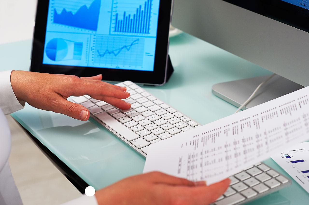 Close up of a financial clerk's hands at work.