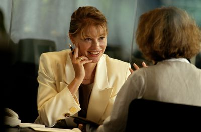 Two female employees participate in a stay interview using these questions.