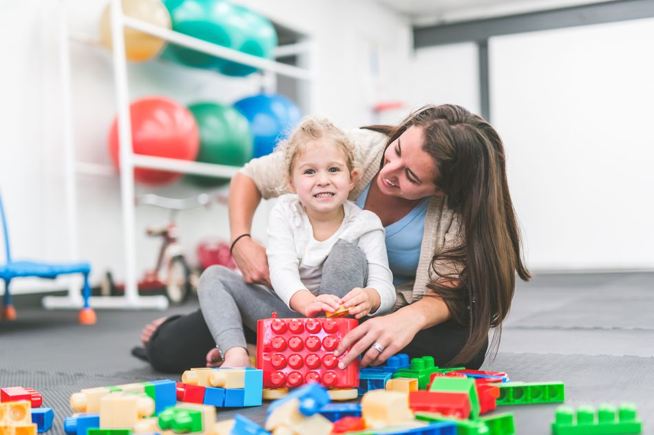 Occupational therapist works with a pediatric patient