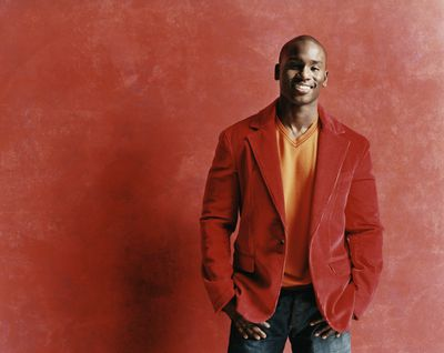Studio Portrait of a smiling young man in a red sport coat