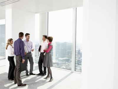 People chatting at a staffing agency