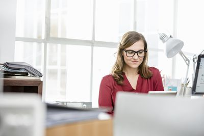 Business woman using laptoo in office